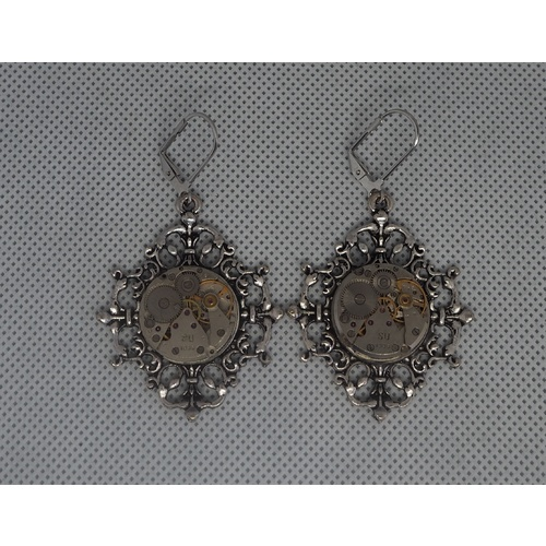Dangly cogs and gears earrings |